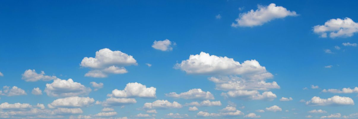 gorgeous white clouds in the blue sky (panoramic picture with copy-space at left top corner)