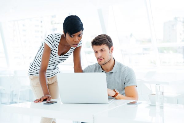 Group of two young business people working in team in office